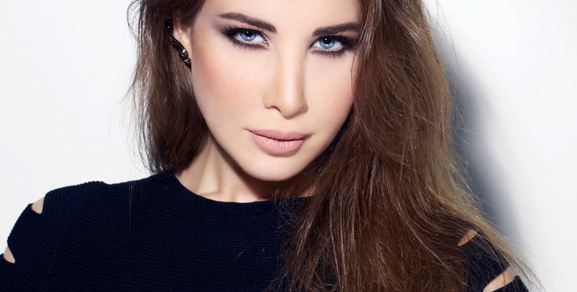"Nancy Ajram Drops ""3am Bet2alla3 Feek"" From Ninth Album!"
